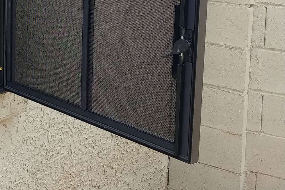 Window security screen with release latch